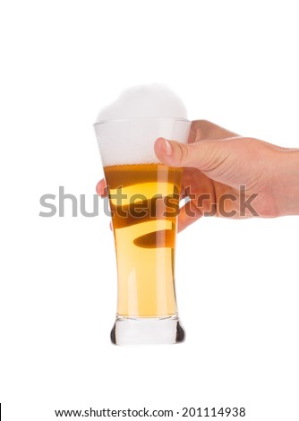 Hand holding beer glass. Isolated on a white background. - stock photo