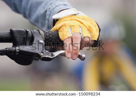Hand holding bicycle handlebar  - stock photo