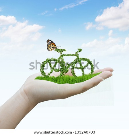 hand holding bicycle made out of green leaves