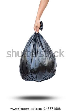 Hand holding black bag of rubbish isolate on white with clipping path - stock photo