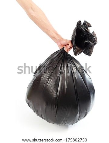 Hand holding black bag of rubbish. White isolated  - stock photo