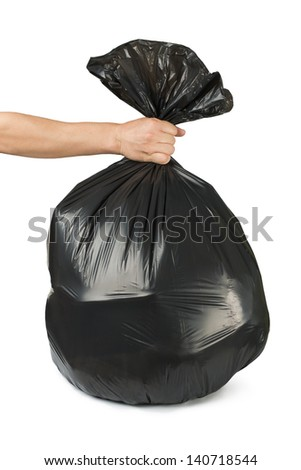 Hand holding black bag of rubbish. White isolated studio shot. - stock photo
