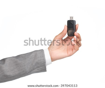 hand holding Black USB memory stick isolated on white background
