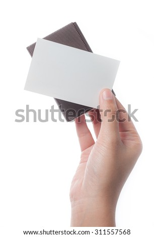 Hand holding blank business card with leather holder isolated on white background