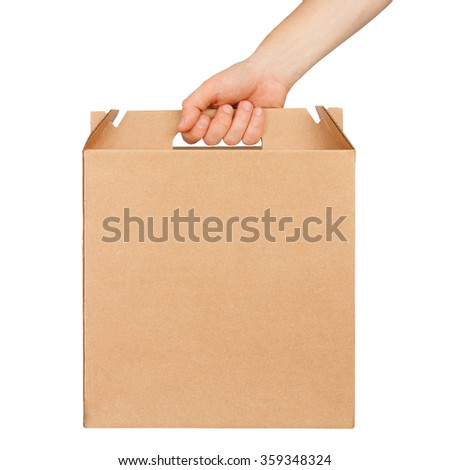 Hand holding blank cardboard box isolated on white background. Delivery concept - stock photo