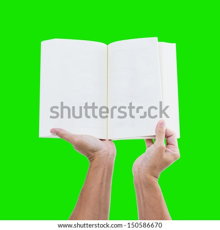 Hand holding blank notebook isolated on green background with clipping path - stock photo