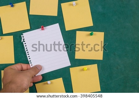 hand holding blank notepaper Blank Yellow paper, posted ,post-it ,note ,Sticky Note? - stock photo