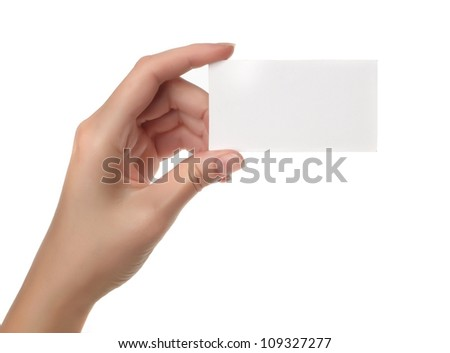 Hand holding blank paper label or tag