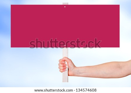 Hand holding blank red sign - stock photo