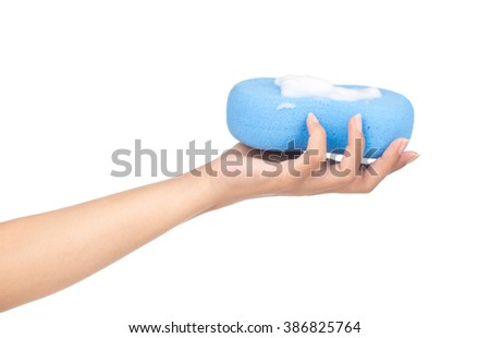Hand holding Blue sponge wet with foam isolated on white background.