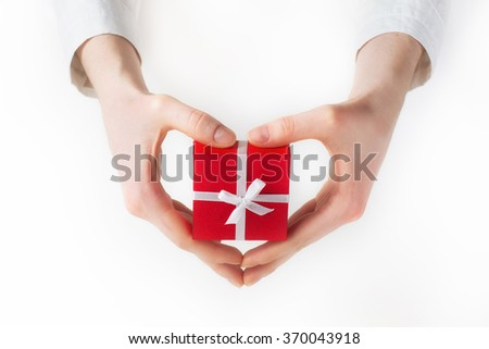 Hand holding box for a gift isolated on white  - stock photo