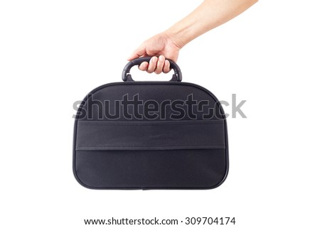 Hand holding briefcase - stock photo