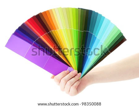 hand holding bright palette of colors isolated on white