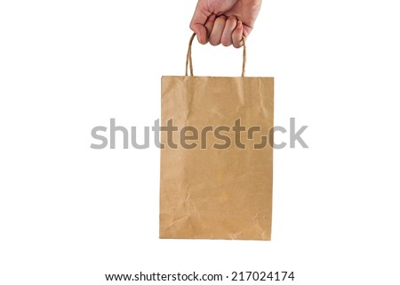hand holding brown paper bag isolated on white background  - stock photo