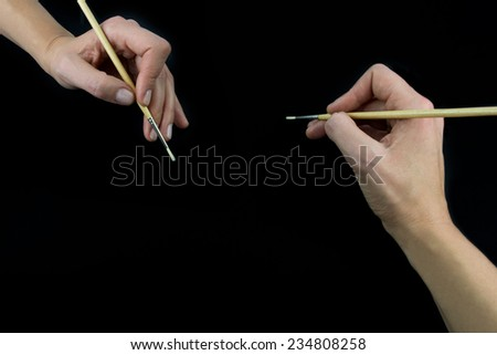 Hand holding brush, set isolated on wblack background