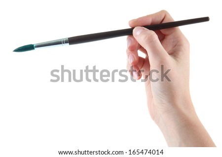 Hand holding brush with green paint isolated on white - stock photo