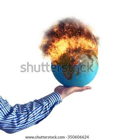 Hand holding, burning world on a fire. - stock photo