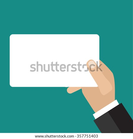Hand holding business card.