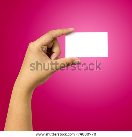 hand holding business card against red background