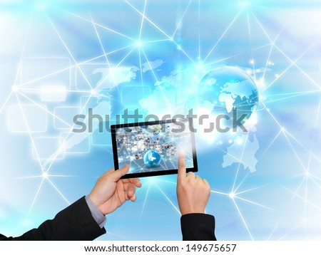 hand holding business world on tablet pc