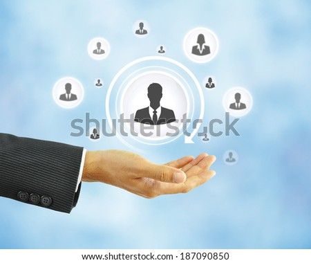 Hand holding businessman icon -  business abstract - HR concept - stock photo