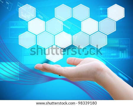 Hand holding button - stock photo