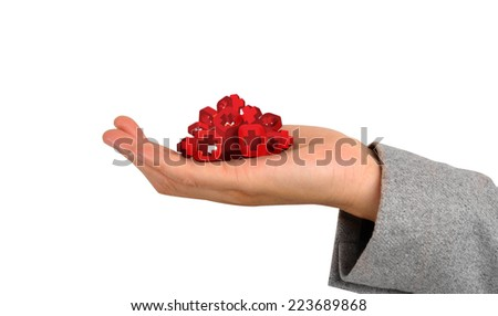Hand holding button with first aid sign - stock photo