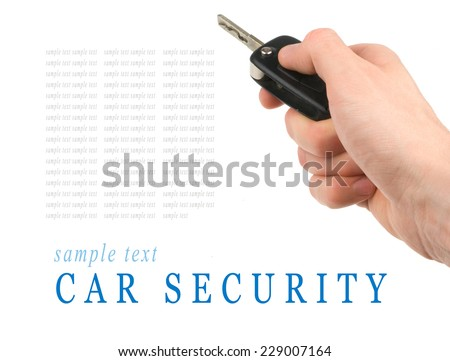 Hand holding car keys isolated on white background - stock photo