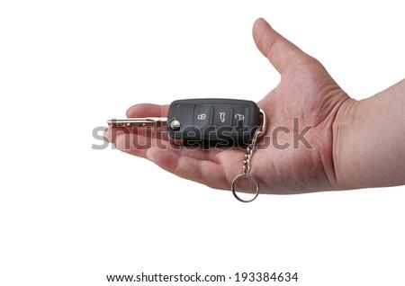 hand holding car keys over white - stock photo