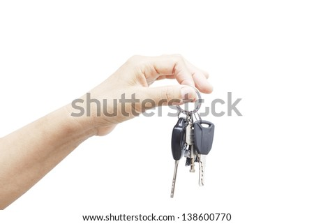 hand holding car keys over white background