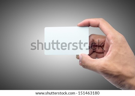 Hand holding card with empty space. - stock photo