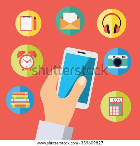 Hand holding cell phone with icons: headphones, photo camera, mail, alarm clock, library books, calculator, organizer.