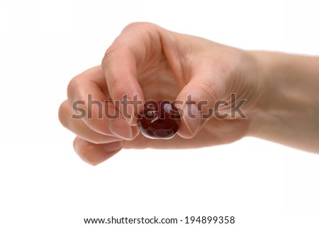 hand holding cherry seasonal fruit isolated on white