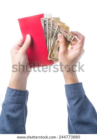 Hand holding chinese red envelope with money isolated over white background