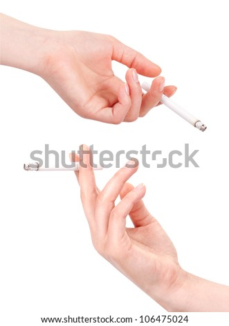 Hand holding cigarette isolated on a white background - stock photo