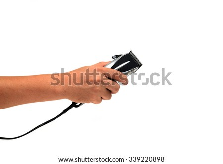 hand holding Clippers isolated on white