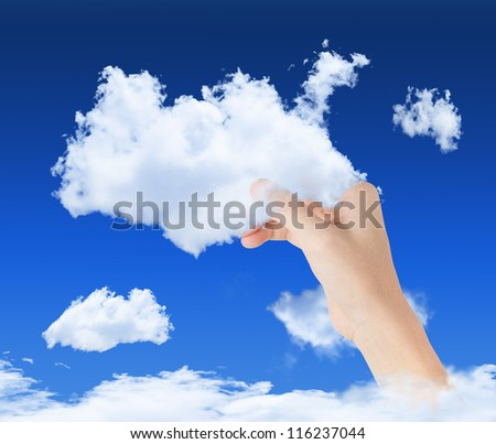 hand holding cloud in blue sky, symbol of cloud computing technology - stock photo