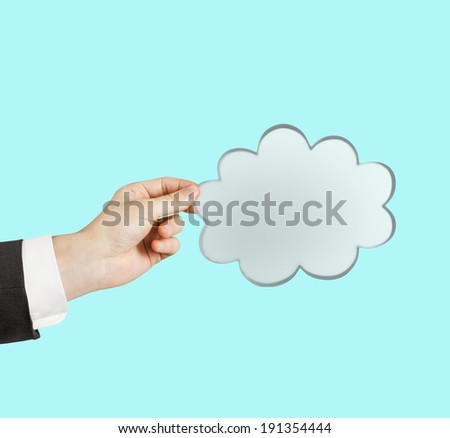 hand holding cloud on a blue  background - stock photo