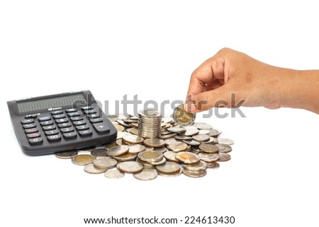 Hand holding coin with calculator isolated on white background - stock photo