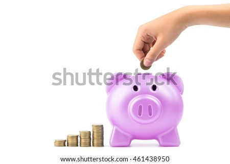 Hand holding coins drop into pink Piggy bank isolated on white background, savings finance concept.