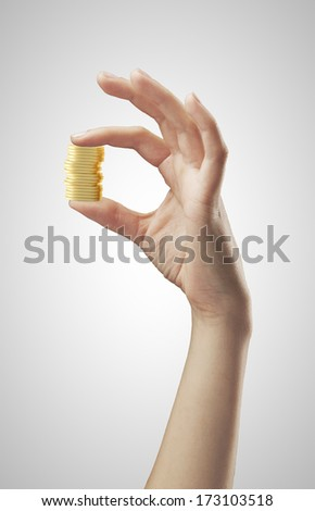 hand holding coins on a white background - stock photo