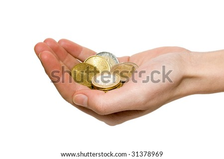 Hand holding coins on a white background