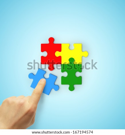 hand holding color puzzle isolated on white - stock photo