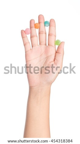 hand holding colorful candy, jellys sweet isolated on white background - stock photo