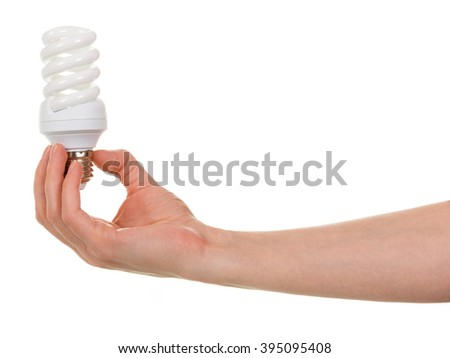 Hand holding compact spiral-shaped fluorescent lamp isolated on white background. - stock photo