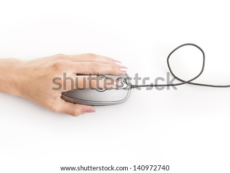 Hand holding computer mouse - stock photo