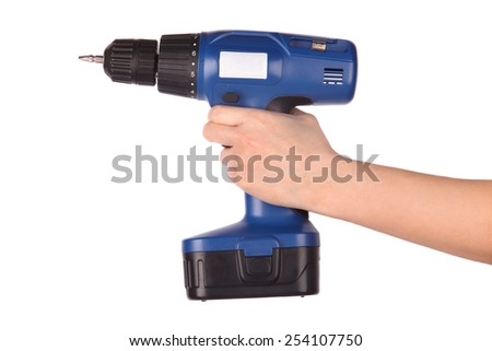 Hand holding cordless screwdriver - stock photo