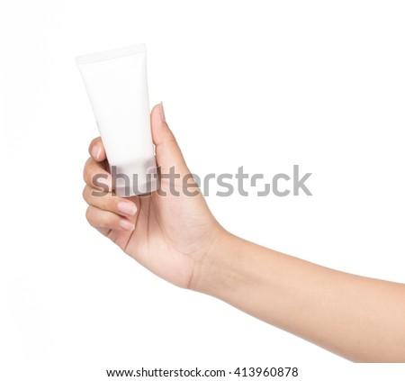 Hand holding Cosmetic plastic tube isolated on white background. - stock photo