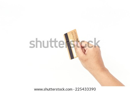Hand holding credit card isolated on white background - stock photo
