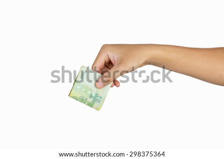 hand holding currency isolated on white background